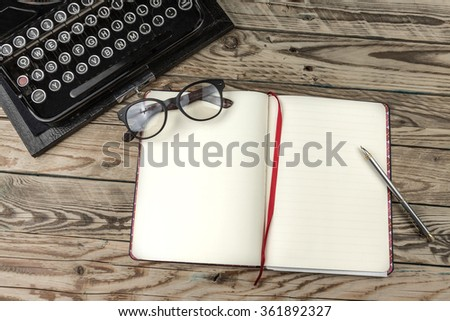 Template mockup copyspace empty white paper  place for your text. Blank open notebook and old fashioned typewriter on wooden table. Theme Writers Editors Journalists Publishers storytellers novelists