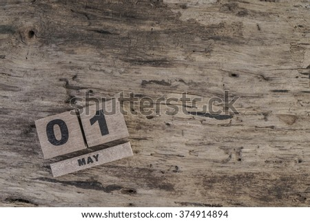 template with cube calendar for may on wooden surface with copy space - stock photo