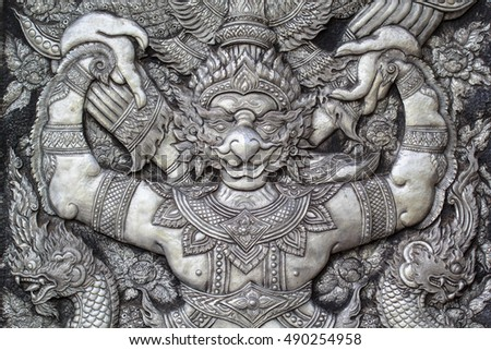 Temple art  plate steel design garuda at the door in thailand