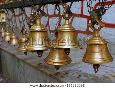 Temple bells, Nepal. Asian spiritual traditions, ritual musical instruments. Temple Puja. A pilgrimage trip to Nepal. Details of a Buddhist temple