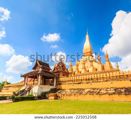 Temple golden Wat Thap Luang in Vientiane, Laos , They are public domain or treasure of Buddhism, no restrict in copy or use  - stock photo