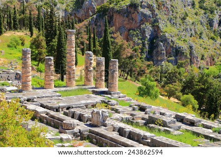 Temple if the Greek god Apollo in sunny valley at Delphi, Greece - stock photo