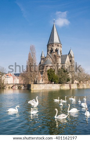 Temple Neuf with swans in Metz - Lorraine, France. This church is a romanesque revival style building.