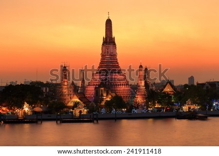 Temple of dawn, The historic landmark in Thailand in the twilight view. - stock photo