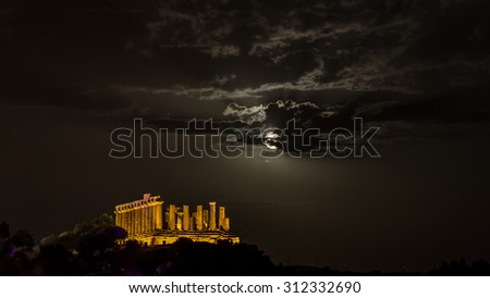 Temple of Juno at night with moon. Valley of Temples, Agrigento. New led lighting system - stock photo