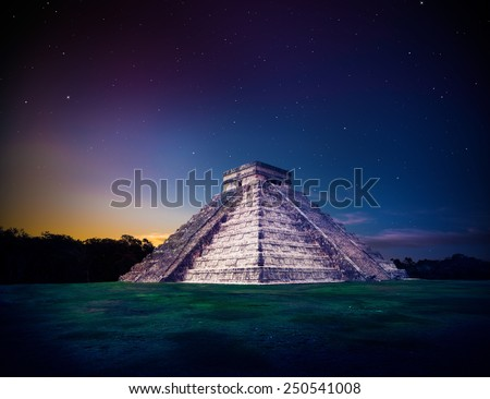 Temple of Kukulkan, pyramid in Chichen Itza, Yucatan, Mexico at night - stock photo