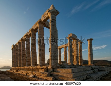Temple of Poseidon at sunset, Cape Sounion, Greece - stock photo