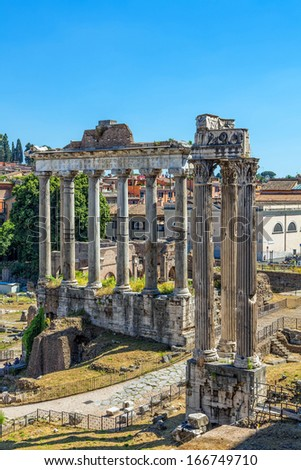 Temple of Saturn and Temple of Vespasian in the Roman forum. Ruins. - stock photo
