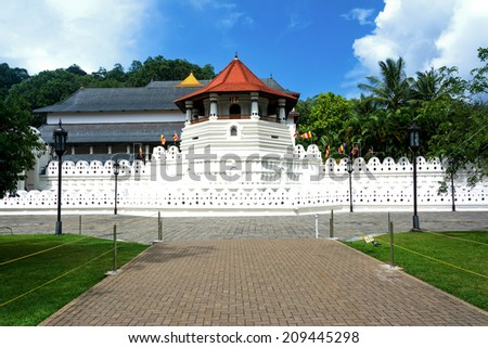 Temple Of The Sacred Tooth Relic, That Is Located In The Royal Palace Complex Of The Former Kingdom Of Kandy – Sri Lanka, Which Houses The Relic Of The Tooth Of Buddha - stock photo