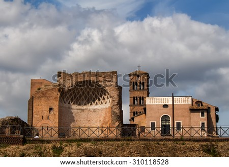 Temple of Venus and Roma, Rome, Italy Ancient roman architecture with a very cloudy sky in the background.