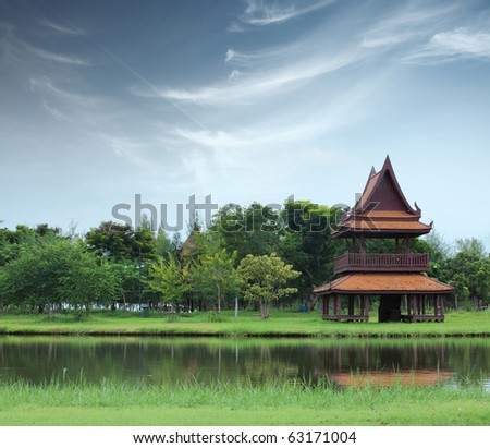 Temple on river side in park