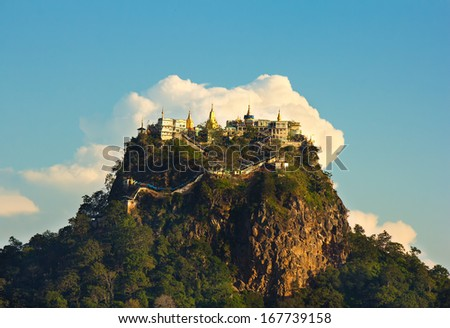 temple on top of a mountain Popa in the clouds, Mount Popa, Myanmar(Burma), november 2014 - stock photo