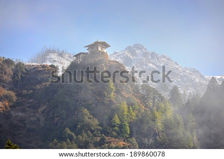 Temple on top of mountain on misty morning ( Paro Taktsang ) - stock photo