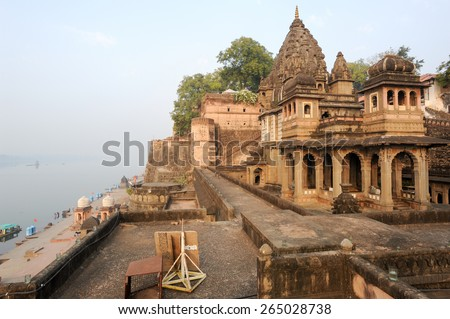 Temple palace of Maheshwar and sacred river Narmada on India - stock photo