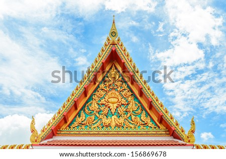 Temple roof,tri-angels roof temple in thailand with blue sky background