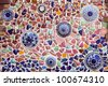 temple wall ornate with traditional chinese ceramic,  Thailand - stock photo