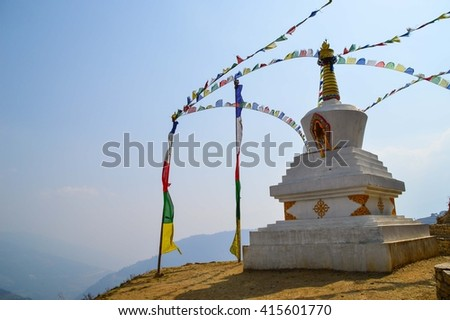 Temple with prayer flags in the mountains, Sagarmartha National Park, Nepal - stock photo