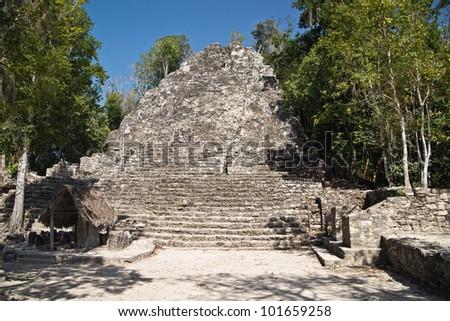 Templo de las Iglesias or Temple of the Church Pyramid and Tunnel Entrance, Coba Maya Ruin - stock photo