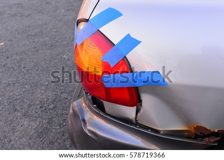 Temporary repair of auto tail light with blue tape.