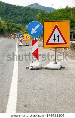 Temporary road construction traffic signs on a road - stock photo