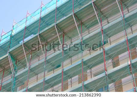 Temporary scaffold for construction works in building site - stock photo