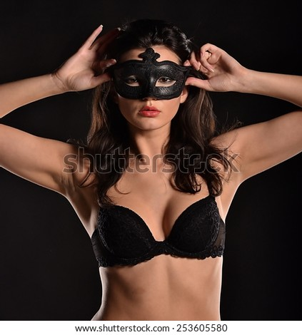 Temptation model in the fashionable mask - stock photo