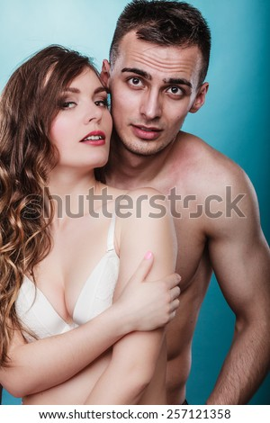 Temptation woman and man. Passionate young people in love. Couple in the passion.
