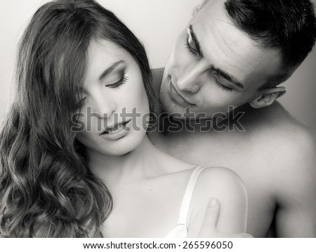 Temptation woman and man. Passionate young people in love. Couple in the passion. Black & white photo - stock photo