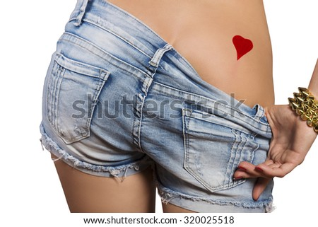 tempting bottom of voluptuous girl with golden bracelet, she is showing her red heart shaped tattoo
