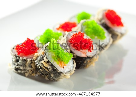Tempura Maki Sushi - Deep Fried Roll made of Fresh Salmon and Cream Cheese inside. Topped with Tobiko Caviar