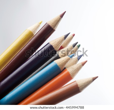 ten colored pastels isolated on light grey  - stock photo