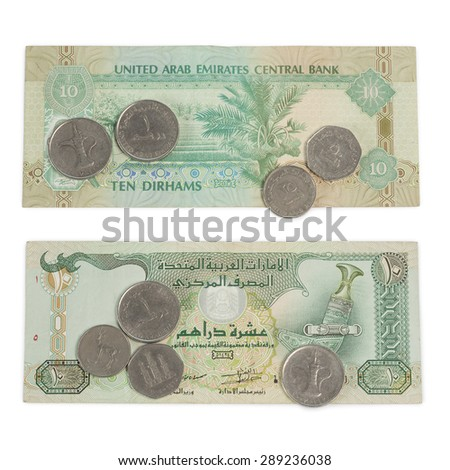 Ten Dirham Note and Coins, Currency of the United Arab Emirates on wooden table