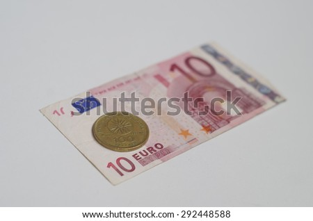 Ten euro banknote and old drams