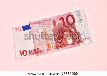 Ten Euro banknote on pink background - stock photo