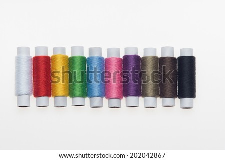 Ten good multi-colored threads for all needs. Isolated on the white background