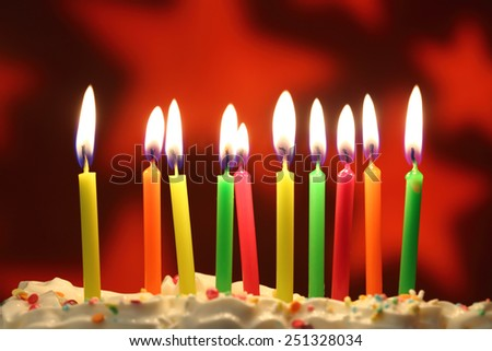 Ten lit birthday candles close up, shallow dof - stock photo