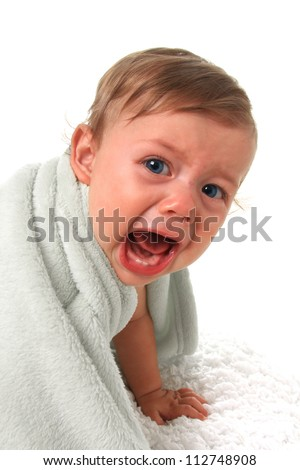 Ten month old baby boy crying. - stock photo