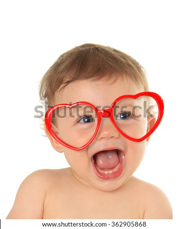 Ten month old baby boy wearing heart shape valentine glasses.  - stock photo