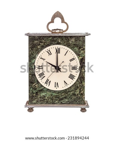 Ten o'clock on isolated mantel clock on white background