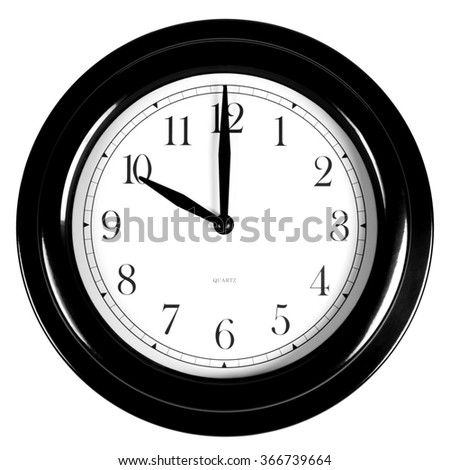 Ten o'clock on the black wall clock, isolated on white background - stock photo