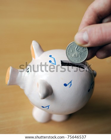 ten pence and piggy bank - stock photo