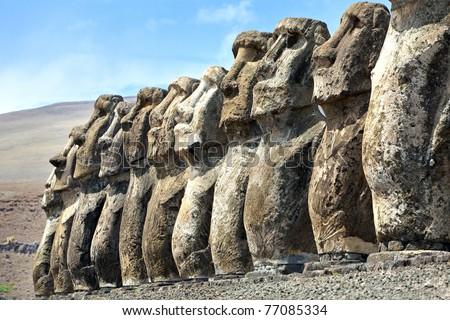 Ten stone moai standing in Easter Island in sunshine - stock photo