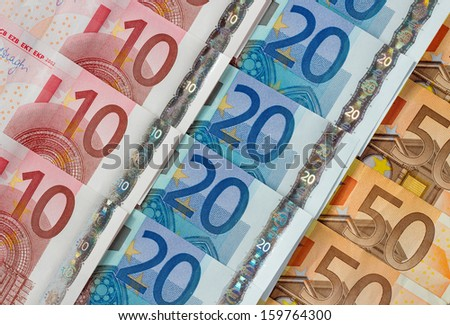 Ten, twenty and fifty euro notes diagonal rows. - stock photo