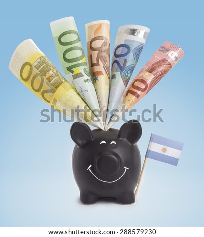 Ten,twenty,fifty,one hundred and a 200 Euro banknote in a smiling piggybank of Argentina.(series) - stock photo