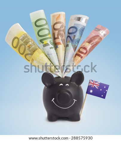 Ten,twenty,fifty,one hundred and a 200 Euro banknote in a smiling piggybank of Australia.(series) - stock photo