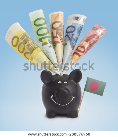 Ten,twenty,fifty,one hundred and a 200 Euro banknote in a smiling piggybank of Bangladesh.(series) - stock photo