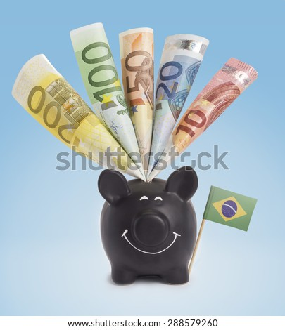 Ten,twenty,fifty,one hundred and a 200 Euro banknote in a smiling piggybank of Brazil.(series) - stock photo
