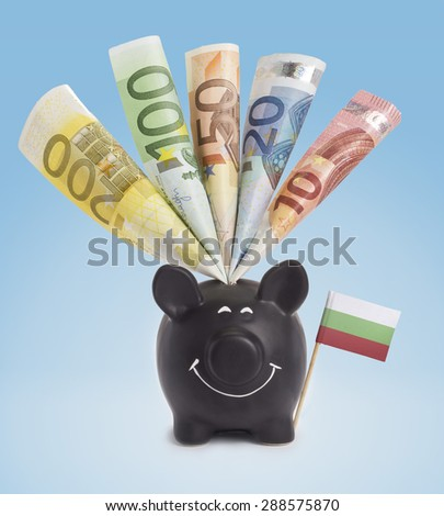 Ten,twenty,fifty,one hundred and a 200 Euro banknote in a smiling piggybank of Bulgaria.(series) - stock photo