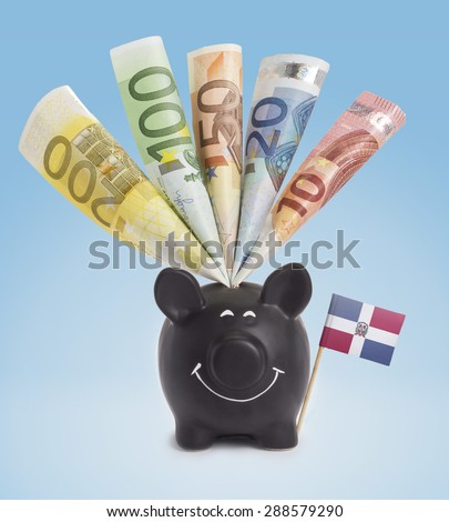 Ten,twenty,fifty,one hundred and a 200 Euro banknote in a smiling piggybank of Dominican Republic.(series) - stock photo