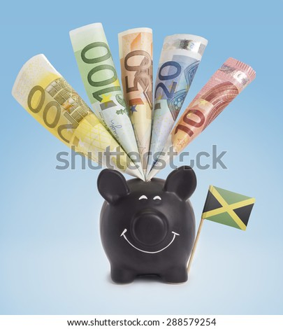 Ten,twenty,fifty,one hundred and a 200 Euro banknote in a smiling piggybank of Jamaica.(series) - stock photo